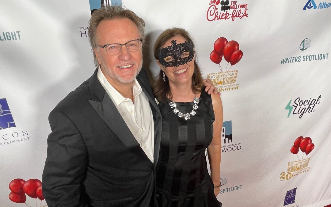 Phil Cooke and Kathleen Cooke on red carpet at Hollywood Prayer Network Anniversary Celebration